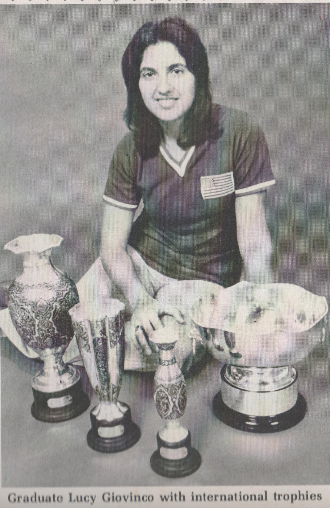lucy_with_trophies_and_world_cup.jpeg
